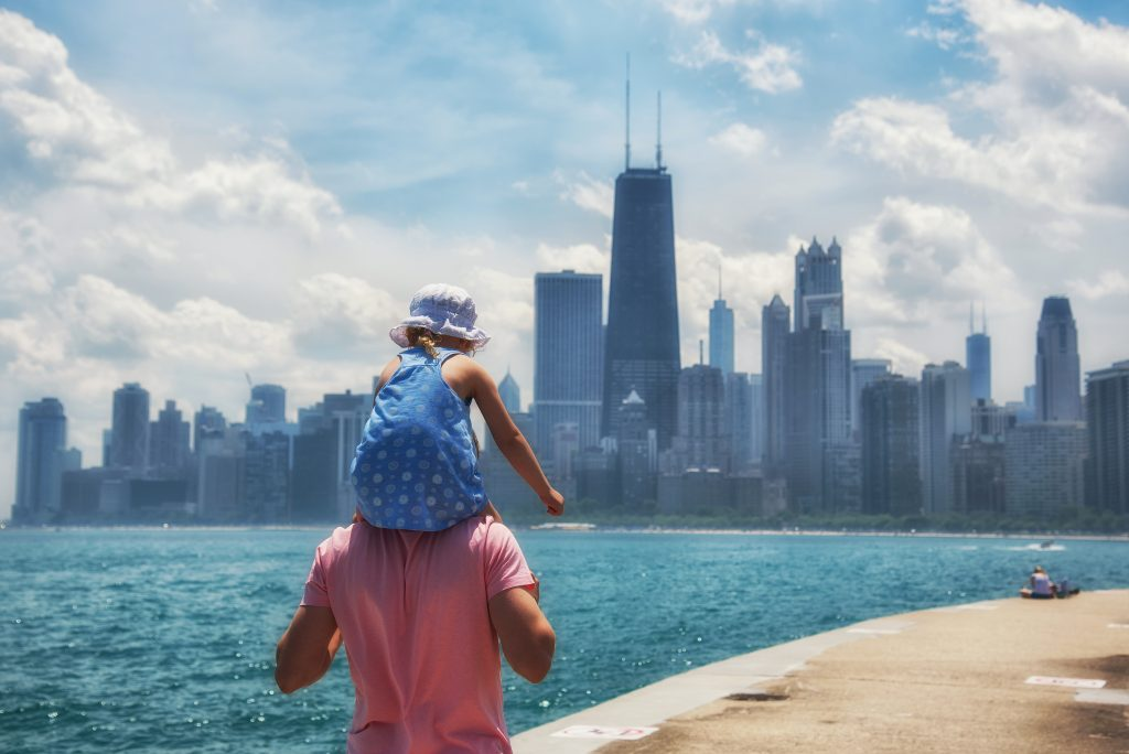 man and child walking Chicago skyline