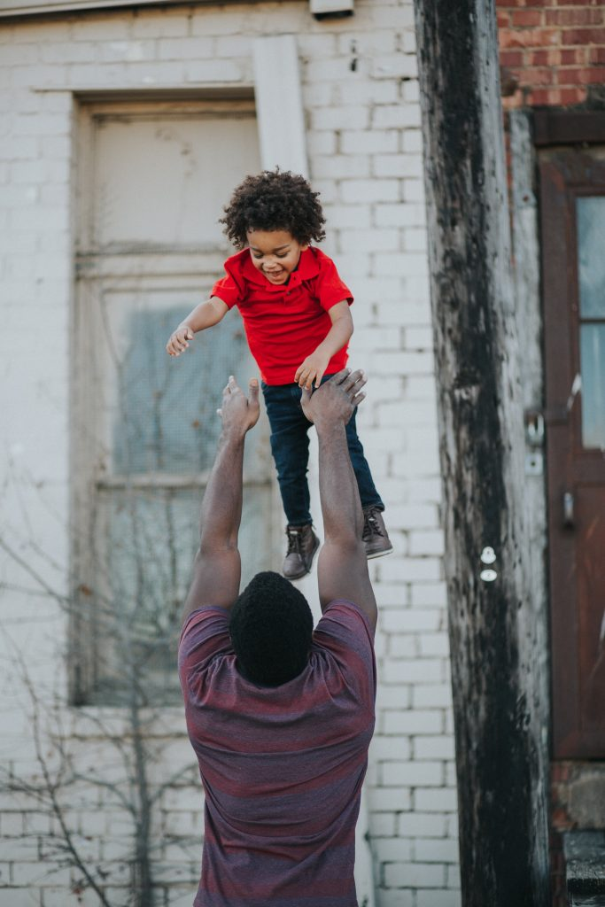 Father tosses son in air
