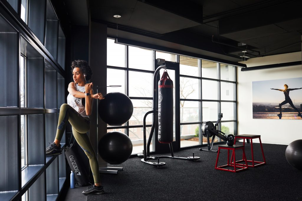Woman stretching in apartment fitness
