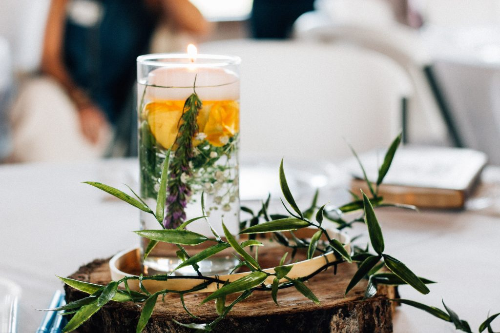 herbs in water with a candle