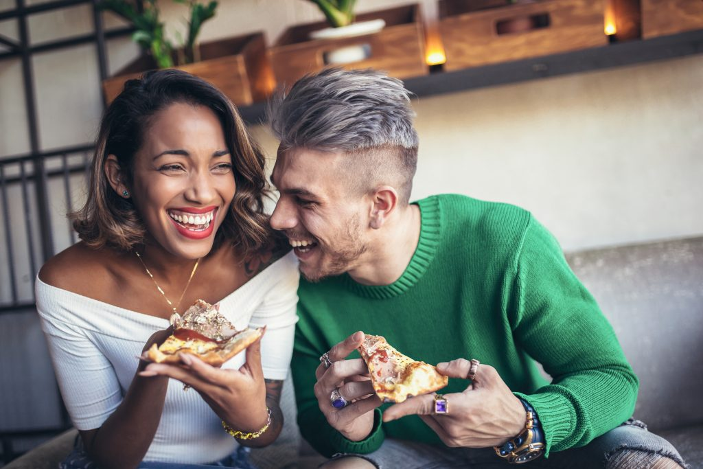 couple eats pizza