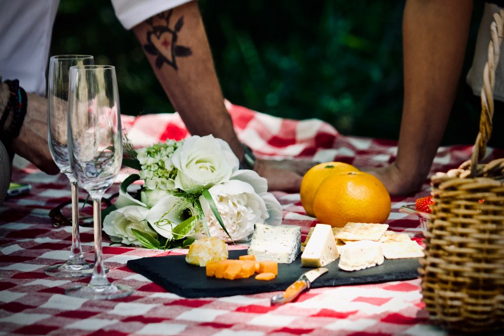 picnic spread with flowers and a cheese spread